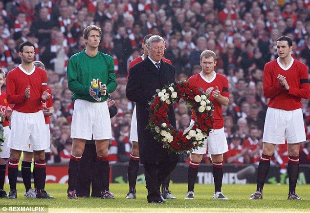 Sir Alex Ferguson holds a wreath to commemorate 50 years since the Munich Air disaster