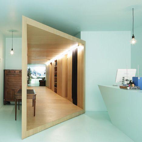 Rectangular timber tunnel inside a Paris cosmetics shop.