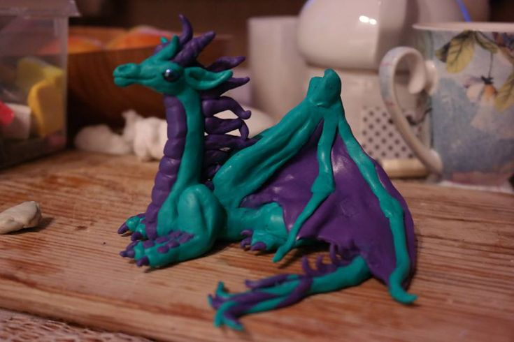 Fimo clay sculpture of dragon.