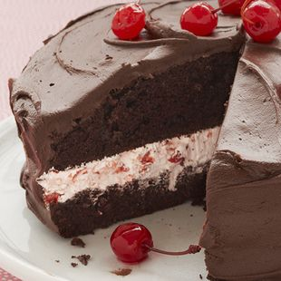 Cherry Jubilee Cake: Sweet cherries and chilled whipped topping sandwiched by rich Duncan Hines Devil's Food Cake, all swathed in a creamy chocolate frosting. Top your Cherry Jubilee Cake with more cherries!