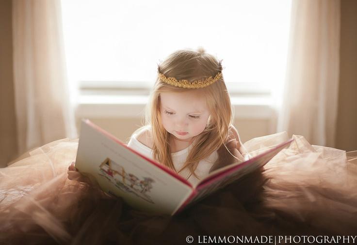 A little princess reading her fairytale