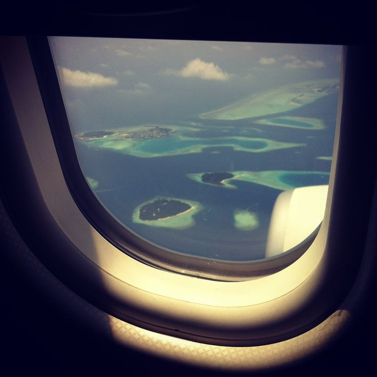 Our favorite view is out of an airplane window: Seen here, the Maledives from above.
