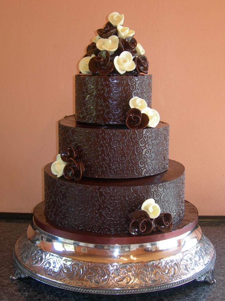Chocolate wedding cake decorated with handcrafted chocolate roses in dark and white chocolate.
