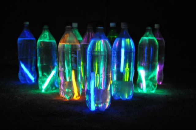 Recycled 2 liter bottles and glow sticks make a great glow in the dark bowling