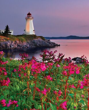 ..Lighthouse At Sunset  A beautiful near dusk view of the Green Point Lighthouse in Green Point, St. George, New Brunswick, Canada.  © Greg McCracken ..