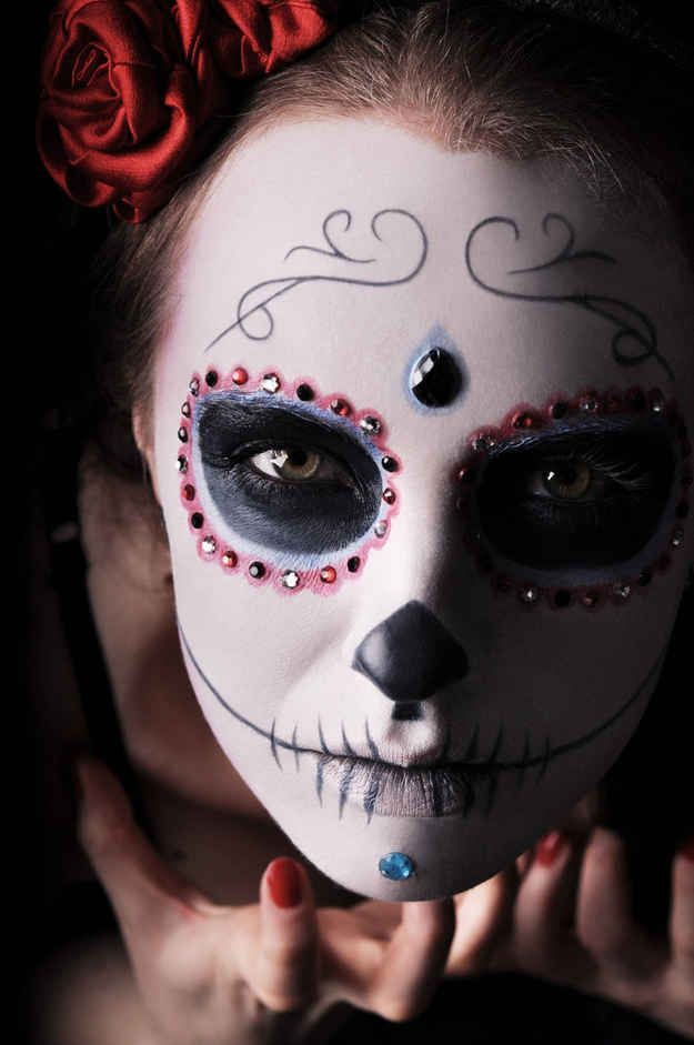 Face painting with bling for Día De Los Muertos