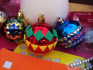 Decorate plain Christmas ball ornaments with some bling bling, stickers, and Sharpie markers!