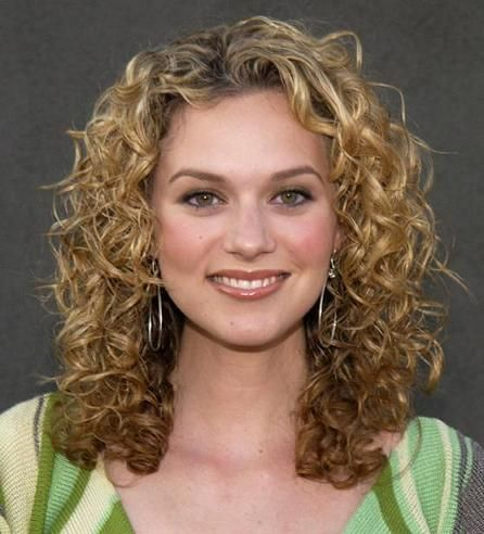 Cute curly haircut.  (My two cents: why don't they teach everyone in beauty school to cut and deal with curly hair?  I swear they just teach them to straighten it. Ugh.)