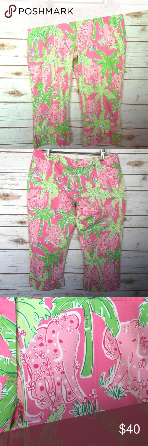 """Lilly Pulitzer Taboo Print Pink Elephant Capris 0P Lilly Pulitzer capri pants in the beloved """"Taboo"""" print featuring palm trees, pink elephants, and lovely flowers. Taboo prints was named one of the top 9 prints from Lilly Pulitzer. Capri length with cuffed bottom and flat front pockets. .*There are two button holes, and one of the buttons is missing as shown in the photos.* Previously owned in Very Good Used Condition.Size:0 Waist:14.5""""across laying flatLength:27 inches Rise: 6…"""