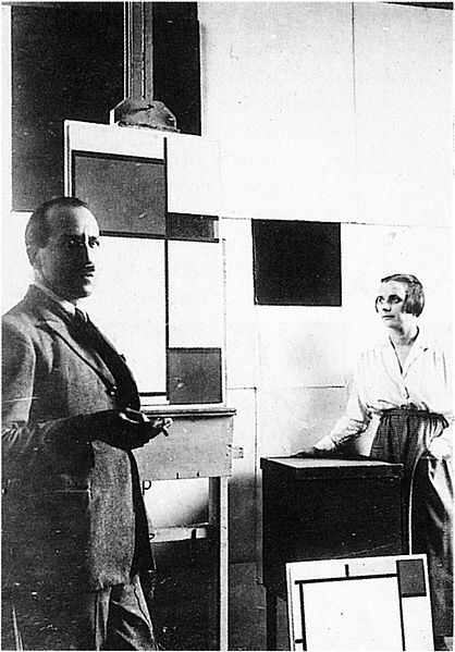 Piet Mondrian and Pétro (Nelly) van Doesburg in Mondrian's studio at Rue du Départ, Paris. 1923. Photo. Published (in altered form) in De Stijl, vol. VI, nr. 6/7 (1924): p. 86.: Vans, Style, Mondrian S Paris, Piet Mondrian, Artist