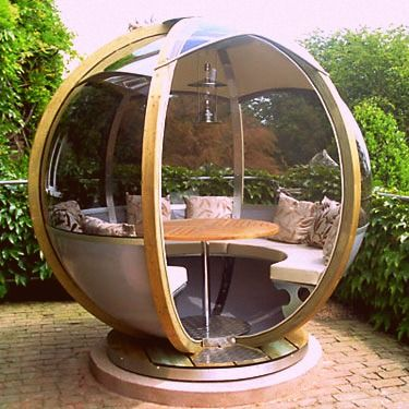 Space Age Garden Pod  I need a Farmer's Cottage sphere lounger in my life. They rotate to keep out the wind or maximize the sun. And the table lowers to form a bed. Really, all it needs is a built-in martini shaker!  :)