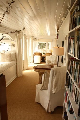 Pretty colors, beadboard ceiling, built in bed and book shelves.