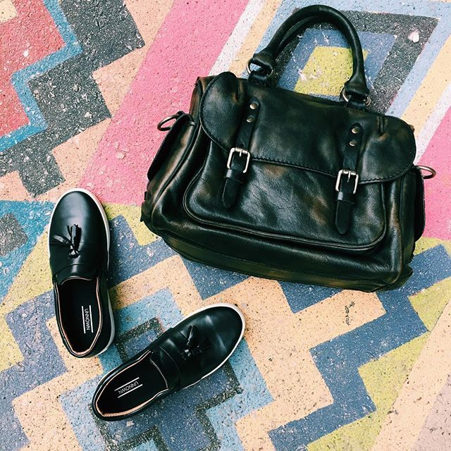 A business-casual loafer-meets-sneaker and a purse that won't commit to one colour.