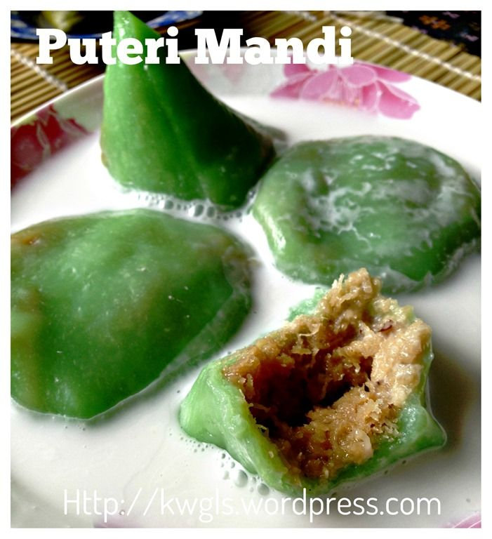 """Kuih Koci......""""Kochi (also known as Passover cake in English) is a Malaysian dumpling (kuih) made from ground unpolished glutinous rice. For the Eurasians in Brunei, Malaysia and Singapore, this snack is often sold at funerals. The black colour of the unpolished rice symbolises death, while the sweet filling represents resurrection."""""""