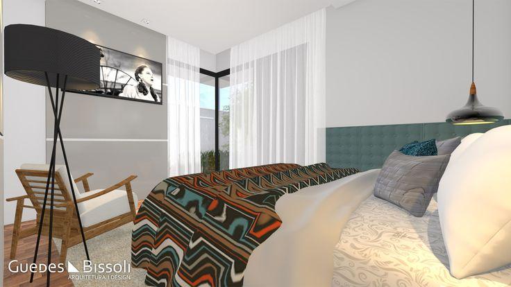 Quarto casal contemporâneo, com ampla área de luz, televisão, cadeira em madeira e estofado branco, e luminárias modernas.