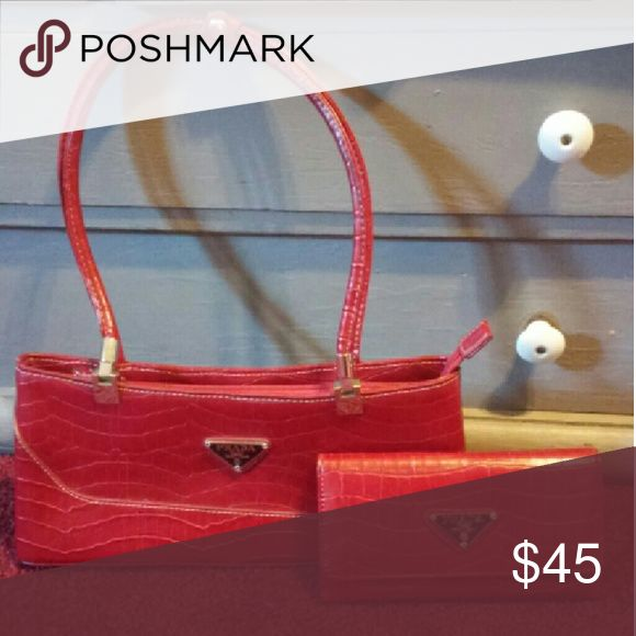 Replica handbag and matching wallet Excellent condition. It is not real! FAKE PRADA! REPEAT FAKE! Comes with matching wallet Bags