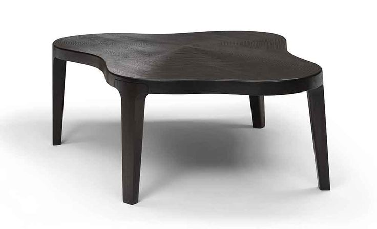 Why must a table be geometrically? Roderick Vos proofs that it can be different with Isola Dining Table.
