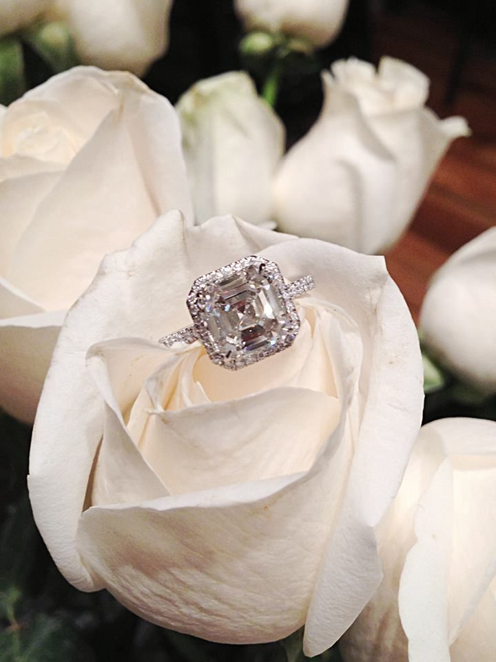 Stunning asscher-cut diamond engagement ring on a platinum and diamond band.