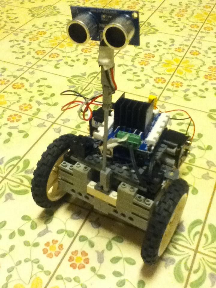 Seeed studio motor shield, Arduino UNO and some Lego parts. Dream it, build it, tweak it and do it all again until your happy with it. Arduino allows you to make your imagination a reality in electronics and programming. Make the move from toys to joys with Arduino UNO.