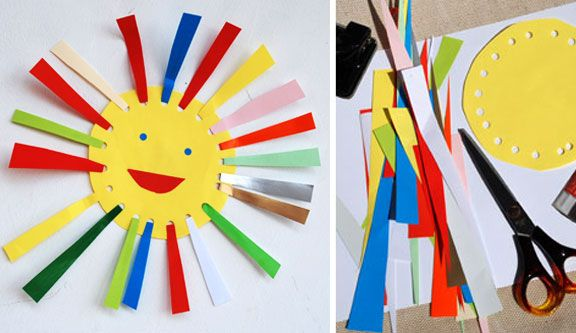cut out triangular strips of colored paper, stick narrow end through punched holes, fold back up and glue to itself.