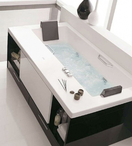 This bathtub has storage built right in! Love the look of the clean, white lines.