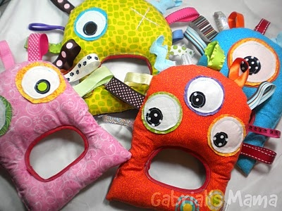 Taggie Monsters. These are stuffed with shopping bag strips; each one takes 8-10 bags.  Good use for scraps. No tutorial, but if I stare at it long enough, I could probably figure it out, maybe? So cute, totally worth a try!