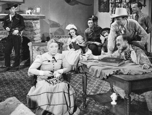 Lee Bennett, Johnny Carpenter, Eddie Dean, Jennifer Holt, Lash La Rue, Emmett Lynn, Sarah Padden, and Don Williams in Song of Old Wyoming (1945)