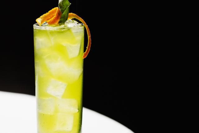 Cocktail recipe for a Melon Patch, a fruity, green, tall drink that uses vodka and melon liqueur. This is a fantastic brunch drink.