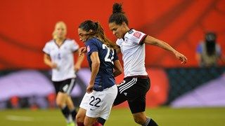 Celia Sasic of Germany is challenged by Amel Majri of France