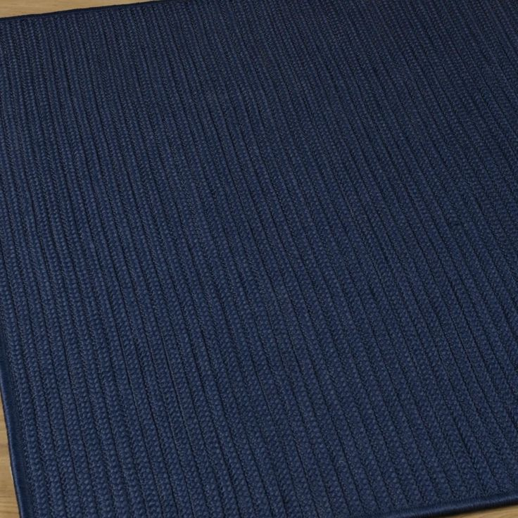 Indoor Outdoor Solid Braids Rug 7 square in navy $358