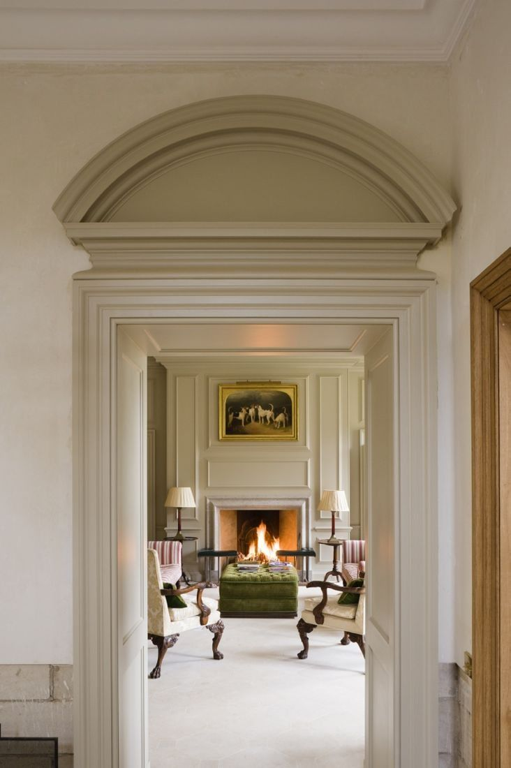 beautiful over the door architectural detail leading into a symmetrical formal living area