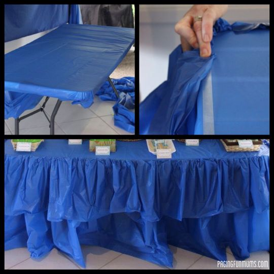 Cheap  Easy Party Table Ruffle! All you need is a roll of plastic table cloth  some double sided tape! Voila!