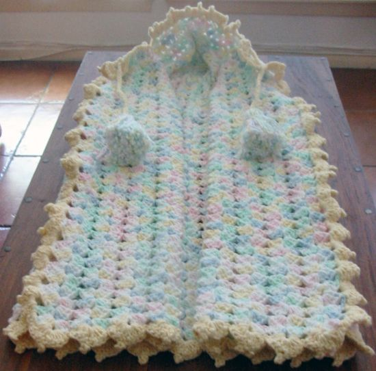 Crocheted Baby Snuggle  http://www.snarledskein.com/2010/02/25/free-pattern-crocheted-baby-snuggle/