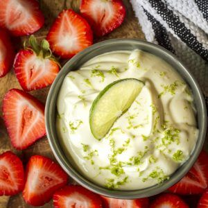 Key Lime Fruit Dip -- whip up this deliciously sweet and tangy fruit dip recipe in under five minutes with just 5 ingredients… Then stand back and watch the fruit fly off the platter!   healthy fruit dip   cream cheese fruit dip   yogurt fruit dip   best fruit dip recipe   easy fruit dip recipe   get the recipe on unsophisticook.com