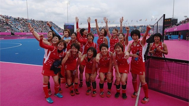 The Japanese women's hockey team pose for a photograph after defeating China…