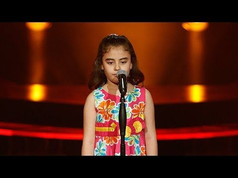 """غنى بو حمدان – اعطونا الطفولة - مرحلة الصوت وبس – MBCTheVoiceKids - The child Ghina Bou Hamdan (Syrian) bursts in tears when she has to sing the words """"Why don't we have festivities and decoration? ....Give us back Peace and Give us our childhood"""", the crowds and artists share her cry """"O people [of the world], my land is set on fire, my land is a stolen freedom, my land is tiny, like me, tiny, Give us back the peace and give us our childhood..."""