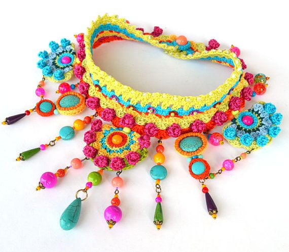 Free form crochet statement choker in colorful cotton,silk and viscose. It incorporates glass beads,artificial turquoise beads, metal elements(do not contain nickel). It fastens with a glass bead button.