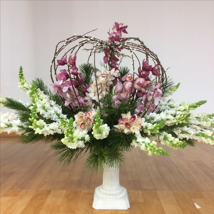 2017.2.5. This week's church flower decoration. Dark pink color orchids, white flower, and leaves.