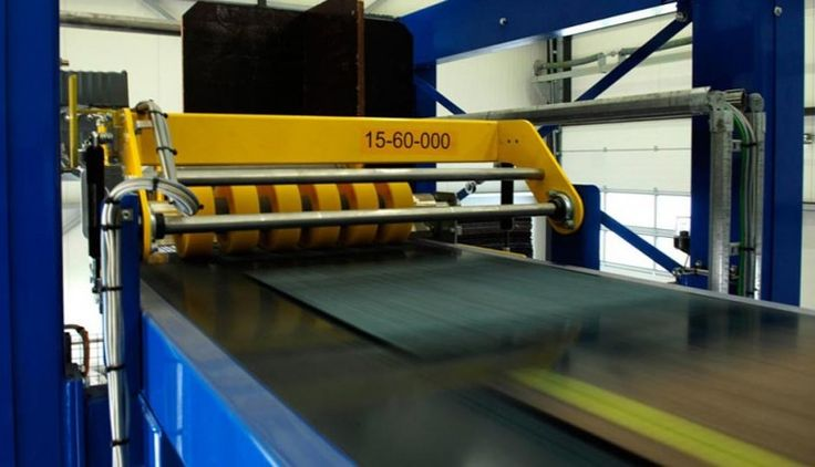 ReEntry® recycling 5 - The carpet tiles enter the process on a conveyor belt., ReEntry