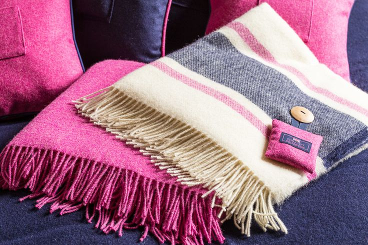 Our Fuchsia and Cream Britannia blankets are 100% British wool and the colours are perfect for the summertime. Cozy up at night and breathe in the soothing aroma of Chilcott lavender, found in the fresh lavender bag buttoned to the corner. #localuk #blankets #chilcottuk #chilcottcolours #wool