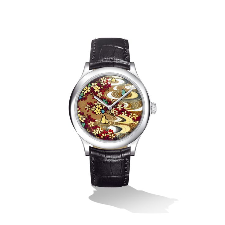 Van Cleef & Arpels has broadened its knowledge of traditional techniques to include the ancient Japanese art of lacquer-work, which makes its own distinctive contribution to the elegance of the men's Extraordinary Dials™ collection.  In a scene from a Japanese garden, the flow of sand between stones finds its echo in a shower of cherry blossom in the Midnight Sakura Watch.  Diameter: 42 mm, Strap: Alligator, Movement: Automatic Piaget 800P