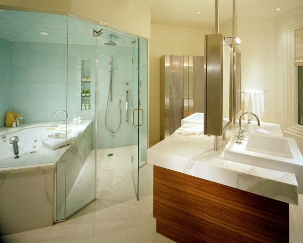 rather than create separate areas for a marble tub and walk in shower both were placed inside a glass enclosure in this modern bathroom - Modern Bathroom