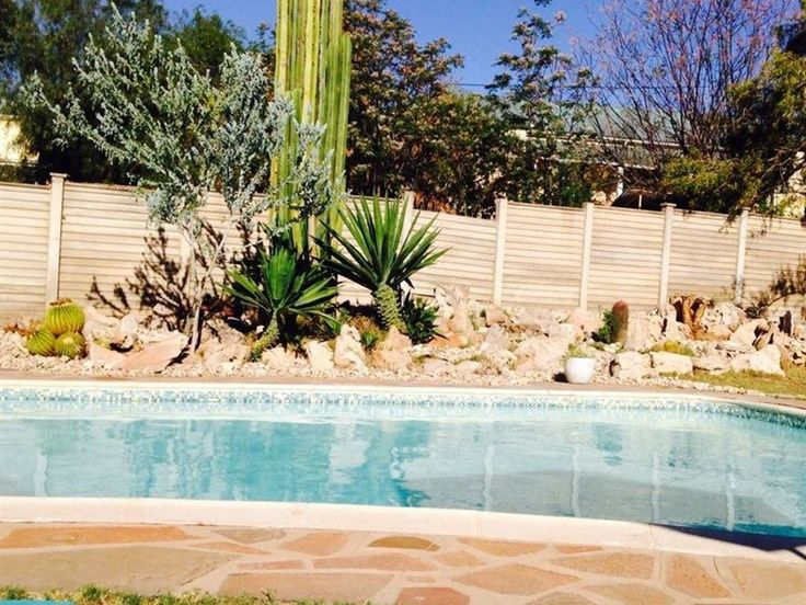 The Golden Barrel - The Golden Barrel Holiday Homes, born from a warm family home, is an oasis in the heart of Oudtshoorn offering pool-side relaxing for summer visits and cosy nights around the fireplace in winter. We provide ... #weekendgetaways #oudtshoorn #southafrica