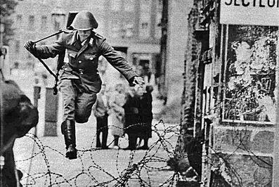 Conrad Schumann leapt over the barbed wire running across one of the side streets leading to Bernauer Strasse. A photographer on the west side captured this amazing photo.