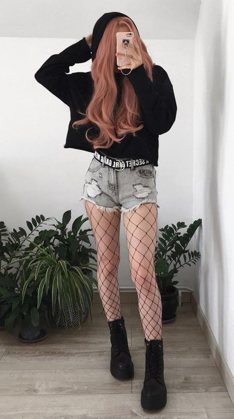 Awesome Black hoodie with denim ripped shorts, oversized fishnet tights & platform boots…