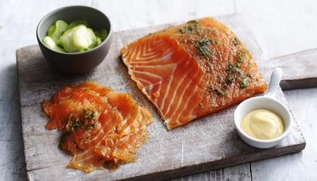 Homemade gravad lax with cucumber salad and mustard sauce  85g/3oz caster sugar 70g/2½oz flaky sea salt 2 tbsp schnapps, gin or vodka 2 tsp freshly ground white pepper 100g/3½oz fresh dill 500g/1lb 2oz centre-cut salmon fillet, skin on, bones removed For the cucumber salad 1 large cucumber, peeled, thinly sliced 1 tsp sea salt 2 tsp caster sugar freshly ground white pepper 1-2 tbsp white wine vinegar