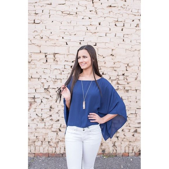 🎉CCO🎉 Navy Top with Sexy Criss-Cross Back Woven top features batwing flutter sleeves and relaxed fit. 100% polyester. Tops
