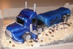 Semi truck shaped chocolate cake for 6th birthday.  All cake except for RKT tires (and stacks). Iced and filled with buttercream and then covered in MMF.