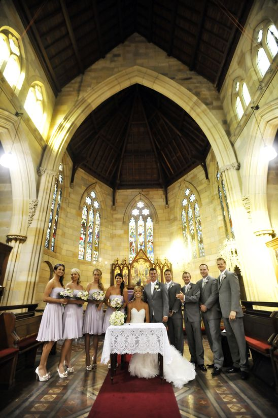 wedding chapel with the bride and groom + their bridal party.  Wedding Photography by Imact Images Photography - www.impact-images.com.au