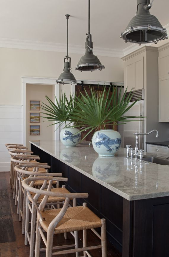 wishbone-barstools-in-kitchen. I love the Belgium or Scandinavian barstools and the Asian planters. By Cynthia Collins of Collins Interiors. I must admit I am tired of obtrusive pendants over an island. I am thinking I would like some clear class pendants instead. Anyone else out there thinking the same thing?